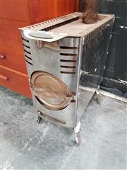 Sale 8822 - Lot 1127 - Wood Burning Heater
