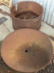 Sale 8984W - Lot 603 - A rusted galvanised bucket together with a mounted plough disk, diameter 70cm