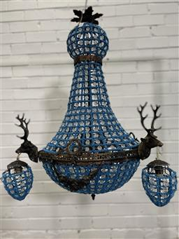 Sale 9154 - Lot 1058 - Blue beaded chandelier with brass stag head mounts - 138 (h80cm)