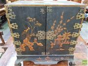 Sale 8444 - Lot 1023 - Antique Georgian Style Black Chinoiserie Table Top Cabinet, with gilt garden scenes, the two doors with pierced & engraved gilt bras...