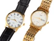 Sale 8837 - Lot 327 - CITIZEN AND AN ELITE GENTS QUARTZ WRISTWATCH; Citizen WR50 ref. 2500-SO28921 with matte dial, center seconds, day date, gold plated...