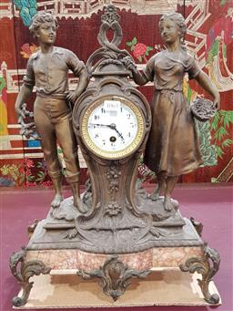 Sale 9097 - Lot 1065 - Early 20th Century French Spelter Timepiece or Mantle Clock, with a young couple standing beside an hour-glass clock with enamel dia...
