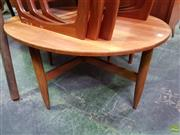 Sale 8607 - Lot 1089 - Teak Oval Coffee Table on Turned Legs