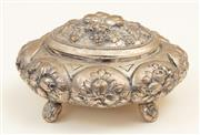 Sale 8855H - Lot 22 - A small silver lidded box decorated with pomegranates and acanthus stamped 800, dimensions Height 7cm, x 13cm x 11cm