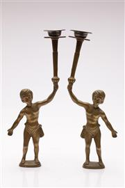 Sale 9057 - Lot 12 - Pair of brass figural tea light holders, with screw fit base (H33cm)