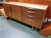 Sale 8607 - Lot 1011 - Compact Teak Sideboard by Sutcliffe of Todmoreden (H: 75 W: 152 D: 46cm)