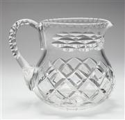 Sale 8660A - Lot 75 - A good quality lead crystal jug with extensive hand cut decoration to the body and handle, c. 1940s, H 15cm