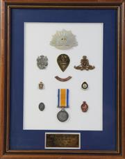 Sale 8994W - Lot 679 - A Framed Medal And Pin Set Awarded To PTE R.J Gladstone (53cm x 43cm)
