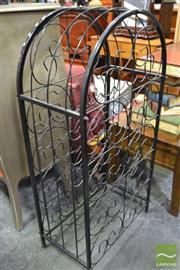 Sale 8489 - Lot 1079 - Metal Cage Form Wine Rack
