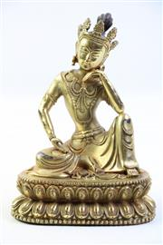 Sale 8997A - Lot 622 - Chinese gilt bronze figure of Avalokiteshvara wearing elaborate crown and jewellery, seated in royal ease pose (H20cm)