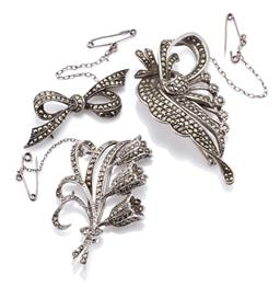 Sale 9169 - Lot 335 - THREE VINTAGE MARCASITE BROOCHES; bow, size 17 x 46mm, lilly of the valley, size 33 x 50mm, and other 30 x 60mm, total wt.34g.