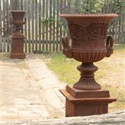 Sale 8871H - Lot 45 - A pair of cast iron campagna urns raised on square form plinths, total height 111cm