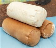 Sale 9066H - Lot 193 - Three cowhide bolster cushions L 40cm