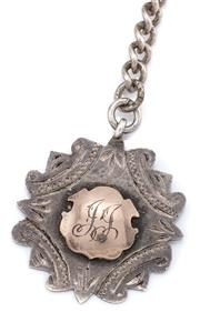 Sale 9074 - Lot 348 - A VINTAGE SILVER ALBERT CHAIN WITH FOB; curb links attached with 2 swivels and a presentation fob applied with an approx. 6ct gold c...