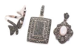 Sale 9169 - Lot 337 - THREE SILVER MARCASITE JEWELLERY ITEMS; wrap around ring, width 35mm, size N, and 2 pendants, a baguette shape, size 45.5 x 23mm, ot...