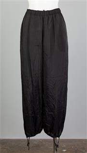 Sale 8661F - Lot 100 - A pair of Comme Des Garcons black cupre/rayon drawstring harem pants, with drawstrings to ankles