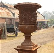 Sale 8871H - Lot 3 - A pair of oversized cast iron urns raised on square plinths, total height 215cm