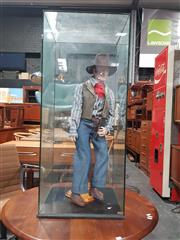 Sale 8705 - Lot 1029 - Ceramic Standing John Wayne Figure in Glass Case