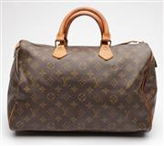 Sale 9074 - Lot 359 - A VINTAGE LOUIS VUITTON SPEEDY BANDOULIERE 35 BAG; rolled leather handles and engraved brass signature padlock, date code 822 indica...