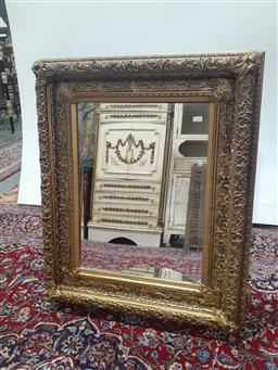 Sale 9085 - Lot 1056 - Ornate Gilt Framed Rectangular Mirror, with deep moulded frame - crack to mirror (116 x 95cm)
