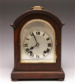 Sale 9107 - Lot 5 - A Timber Bound Domed Mantle Clock (H 32cm, Untested)