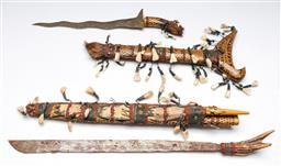 Sale 9156 - Lot 95 - A handpainted kris and a bone handled knife (L:45cm and 60cm)