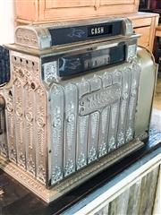 Sale 8516A - Lot 72 - An iconic National cash register in rare polished nickel finish, c1890s (last patent pending), mounted on its original base plate....
