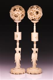 Sale 9081 - Lot 82 - A Pair Of Ivory Carved Puzzle Balls With Figural Bases H:26cm