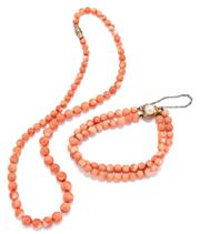 Sale 9074 - Lot 365 - A VINTAGE CORAL NECKLACE AND BRACELET; 4.9 - 8.2mm graduated bead necklace to metal screw clasp, length 42cm, and a 6mm round 2 row...