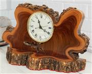 Sale 9066H - Lot 199 - An unusual timber slice mantle clock fashioned by Roger Rogerson whilst doing time. H 29cm W 47cm