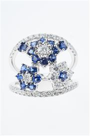 Sale 8347J - Lot 394 - AN 18CT WHITE GOLD SAPPHIRE AND DIAMOND RING; centring three floral clusters of round cut blue sapphires and round brilliant cut dia...