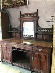 Sale 8868 - Lot 1090 - Late Victorian Walnut Sideboard, with central mirror flanked by shelves, above three drawers and alcove flanked by two panel doors