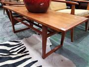 Sale 8930 - Lot 1098 - 1960s Teak Coffee Table with Magazine Shelf