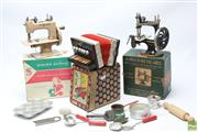 Sale 8644 - Lot 7 - Childs Singer Sewing Machine Together with Another, Dolls Cooking Equipment and A Baby Accordion