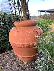 Sale 9005H - Lot 12 - A large terracotta baluster form garden pot with banded decoration.