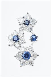 Sale 8347J - Lot 397 - AN 18CT WHITE GOLD DIAMOND AND SAPPHIRE PENDANT; three floral clusters set with round cut blue sapphires and 17 round brilliant cut...