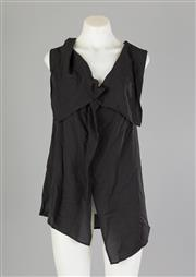 Sale 8661F - Lot 79 - An Ann Demeulemeester black silk, sleeveless shirt with oversized collar lapels, size 42