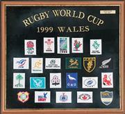 Sale 8988 - Lot 1023 - Rugby World Cup 1999 Framed Embroidered Country Badges (H: 56.5 x W: 60.5cm)