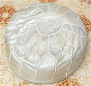 Sale 9066H - Lot 202 - A Moroccan silver leathered pouffe. Diameter 50cm