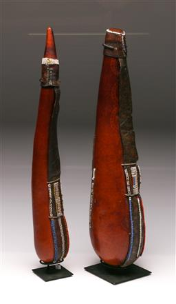 Sale 9110 - Lot 30 - 2 Kenyan Maasai leather clad gourds (H:55cm)