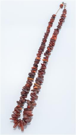 Sale 9037F - Lot 83 - A GRADUATED DARK AMBER BEAD NECKLACE; 8 - 26mm amber shards, length 68cm.