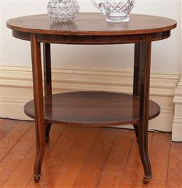 Sale 9190H - Lot 32 - An antique Brazilian rosewood English oval two tier centre table C: 1890. The oval top inlaid with 3 bands of boxwood stringing and...