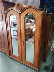 Sale 8666 - Lot 1074 - Late 19th Century Continental Walnut Armoire, with two arched mirror panel & cross-banded doors, with conforming cornice and central...