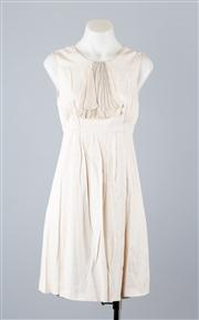 Sale 8685F - Lot 73 - A Lisa Ho sleeveless cocktail dress in champagne with a contemporary jabot design and pleating to the skirt, size AU 8