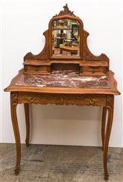 Sale 8516A - Lot 83 - A French Louis XV style walnut dressing table, with rouge marble top, and tilting bevelled mirror, with carved peak, c1900-1910. 1...