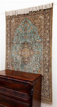 Sale 8735 - Lot 16 - A Cadrys Persian silk carpet, central medallion in earthy tones on a blue ground 221cm x 130cm