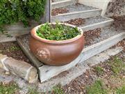 Sale 9005H - Lot 13 - A brown circular garden pot with lion mask design. H-31cm D-58cm