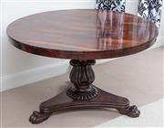 Sale 9070H - Lot 81 - A William IV Rosewood circular tilt top pedestal table on tripod base with lion paw feet, Height 74cm, Diameter 124cm