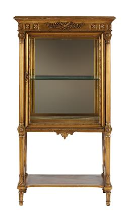 Sale 9245J - Lot 47 - A fine and rare French 19th century giltwood single door vitrine, with detailed hand carved floral decoration, fitted with a lower s...