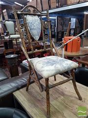 Sale 8554 - Lot 1049 - Tiger Cane Chair